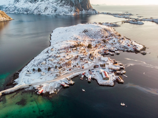 Aerial view of archipelago with fishing village in surrounded mountain on winter season