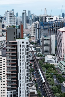 Aerial view of bangkok city with crowded building and public skytrain at thailand