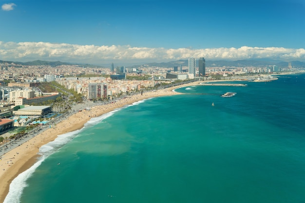 Aerial view of barcelona, barceloneta beach and mediterranean sea in summer day