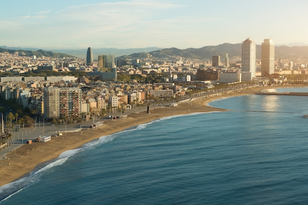 Aerial view of barcelona beach in summer day along seaside in barcelona, spain.