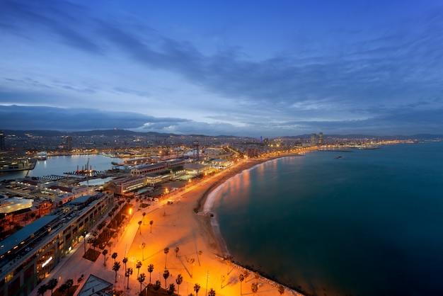 Aerial view of barcelona beach in summer night along seaside in barcelona, spain.
