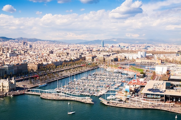 Aerial view of barcelona city with port vell
