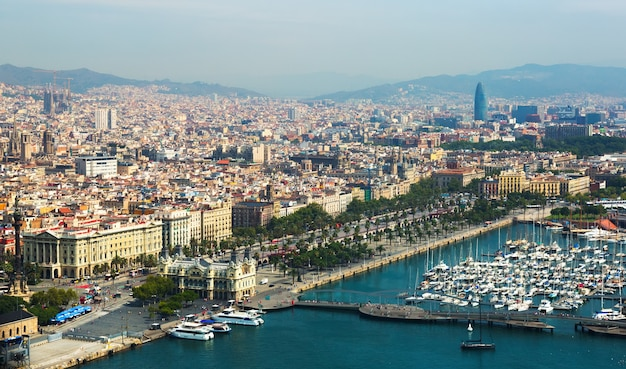 Aerial view of barcelona with port from helicopter