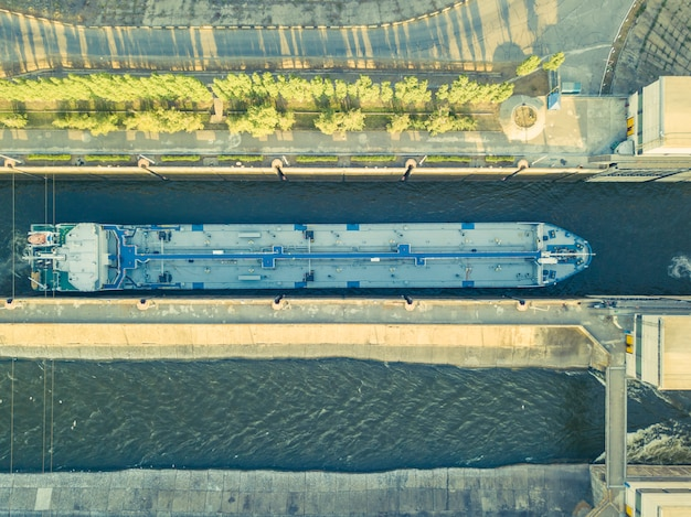 Aerial view of barge ship on the river in gateway dock.