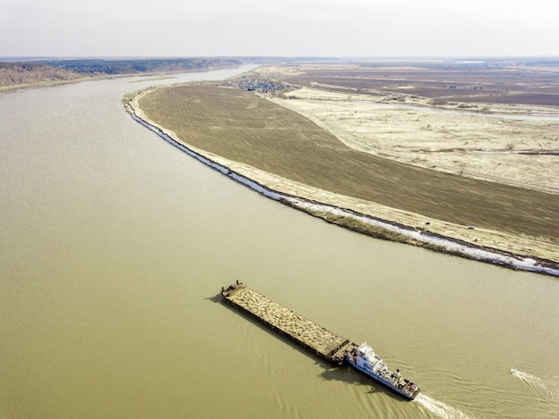 Aerial view of barge on tom river, early spring in siberia, tomsk, russia.