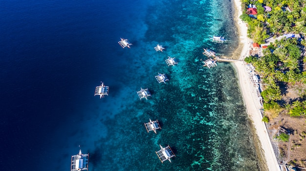 Aerial view bay and shore in oslob, cebu, philippine, it is a best place to snorkel and scuba drive and whale shark watching.