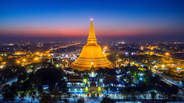 Aerial view of beautiful gloden pagoda at sunset. phra pathom chedi temple in nakhon pathom province, thailand.