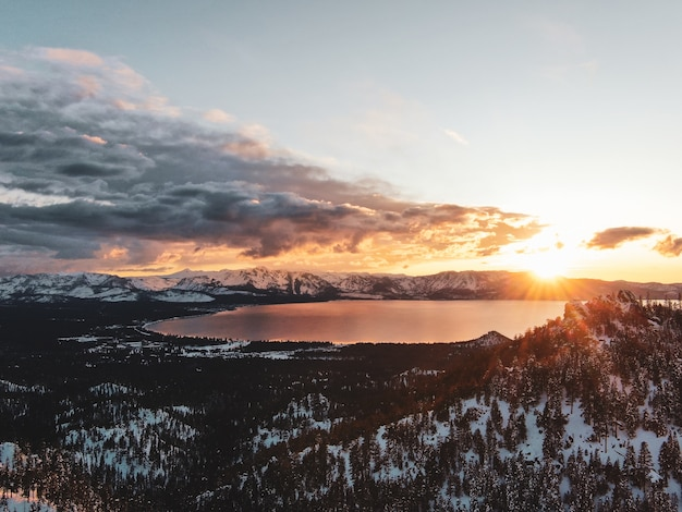 Aerial view of the beautiful lake tahoe captured on a snowy sunset in california, usa