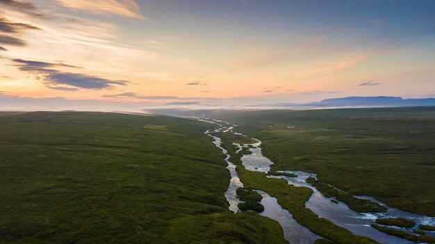 Aerial view beautiful landscape of meadow and mountain at morning in iceland, summertime