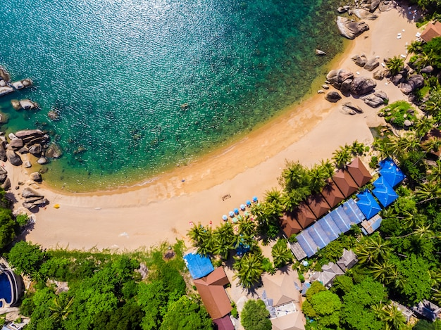 Aerial view of beautiful tropical beach and sea with palm and other tree in koh samui island