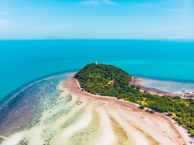 Aerial view of beautiful tropical beach and sea with trees on island