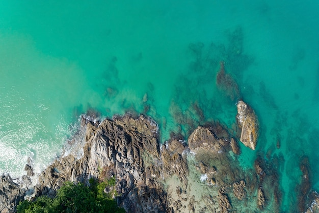 Aerial view beautiful turquoise sea with rocks surface in sunny day