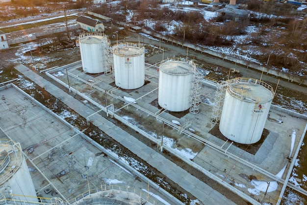 Aerial view of big fuel reservoires in petrol industrial zone in winter.