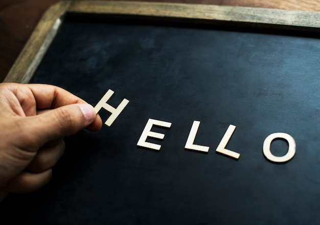 Aerial view of black board with the letter forming hello greeting concept