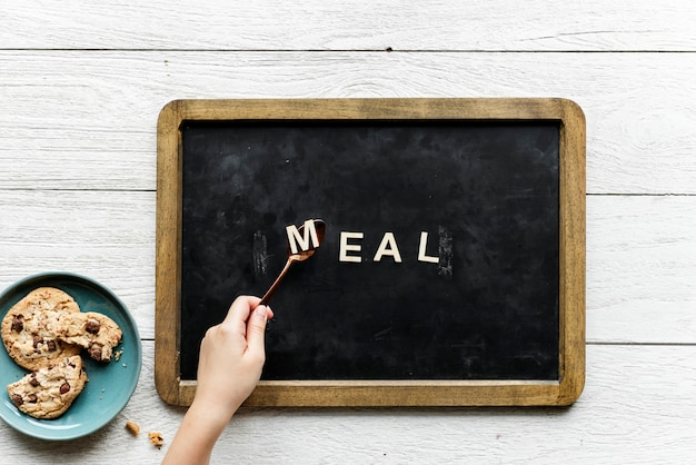 Aerial view of black board with the word meal