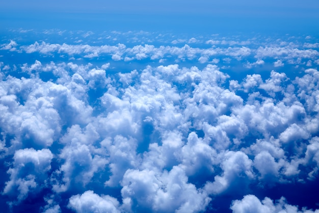 Aerial view of blue clouds on blue sea