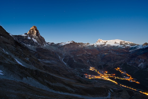 Aerial view of breuil cervinia village glowing in the night