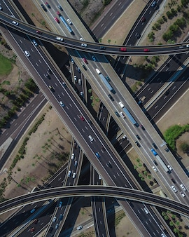 Aerial view of a busy highway intersection full of traffic during daytime