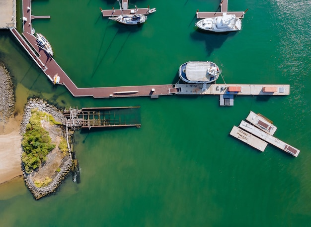 Aerial view by small group of sail boats in a marina sunny summer day