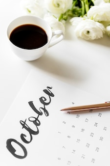 Aerial view of calendar with coffee cup