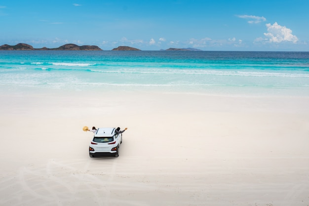 Aerial view of car parking in beach at lucky bay in cape le grand national park, near esperance, western australia, australia. travel and vacation concept.