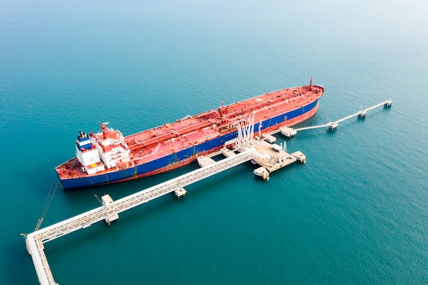 Aerial view cargo ship of business logistic sea freight, crude oil tanker lpg ngv at industrial estate thailand / group oil tanker ship to port of singapore - import export