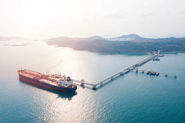 Aerial view cargo ship of business logistic sea freight, crude oil tanker lpg ngv at industrial estate thailand / group oil tanker ship to port of singapore - import export Premium Photo