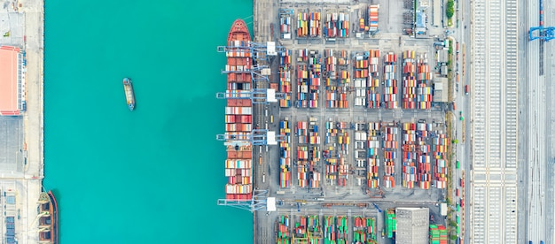 Aerial view cargo ship of business logistic transportation sea freight,cargo ship, cargo container in factory harbor at industrial estate for import export around in the world