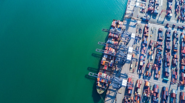 Aerial view of cargo ship and containers