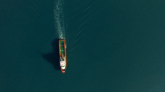 Aerial view of cargo ship for logistics import export, shipping or transportation