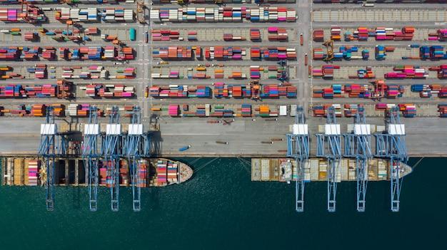Aerial view cargo ship terminal, unloading crane of cargo ship terminal.