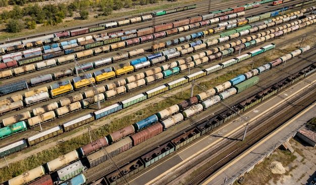 Aerial view of cargo train depot station shipping and transport wagons, industry concept  f