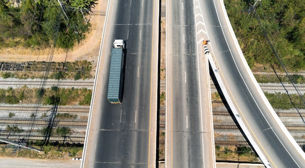 Aerial view of cargo truck on highway road with blue container, transportation concept.,import,export logistic industrial transporting land transport on the asphalt expressway