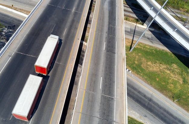 Aerial view of cargo white truck on highway road with container, transportation concept.,import,export logistic industrial transporting land transport on the asphalt expressway