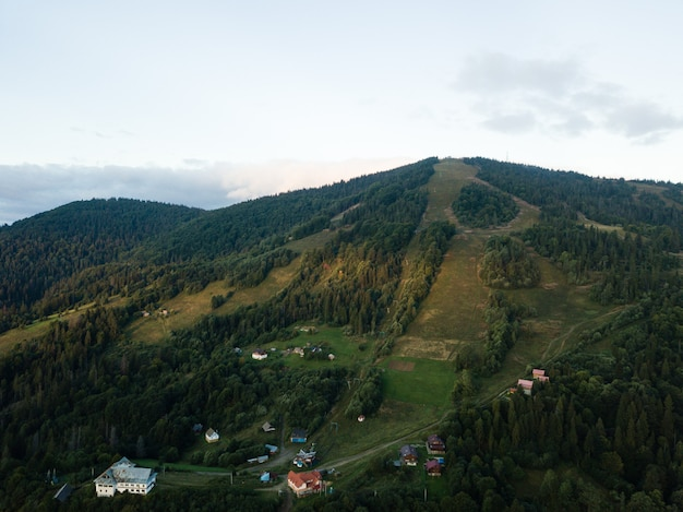 Aerial view to carpathian village slavske with moutains