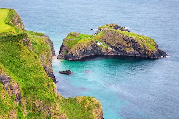 Aerial view of the carrick-a-rede rope bridge and carrickarede island, uk