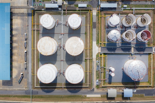Aerial view of chemical industry storage tank and tanker truck in wailting in industrial plant to tranfer oil to gas station.