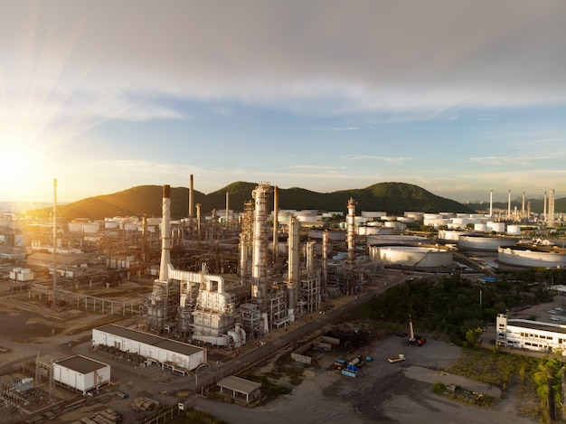Aerial view of chemical oil refinery plant, power plant at sunset sky for industry concept
