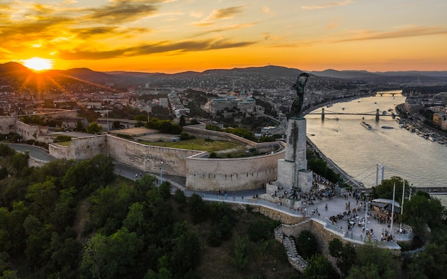 Aerial view of citadella and liberty statue in budapest before sunset