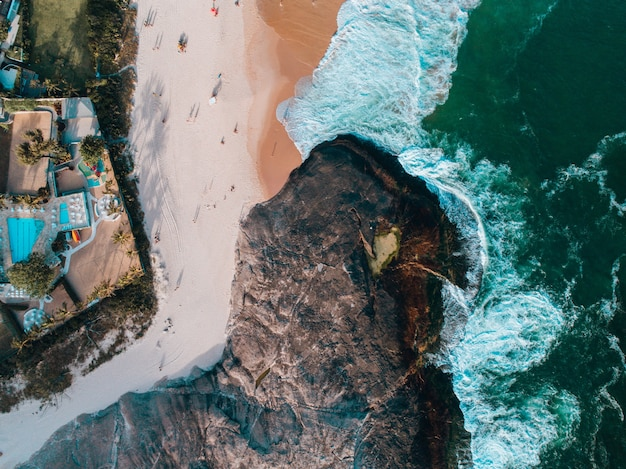 Aerial view of a cliff and the sandy beach in brazil