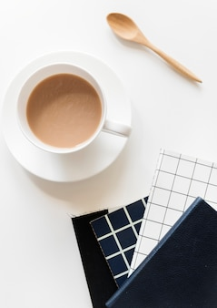 Aerial view of coffee cup with notepads