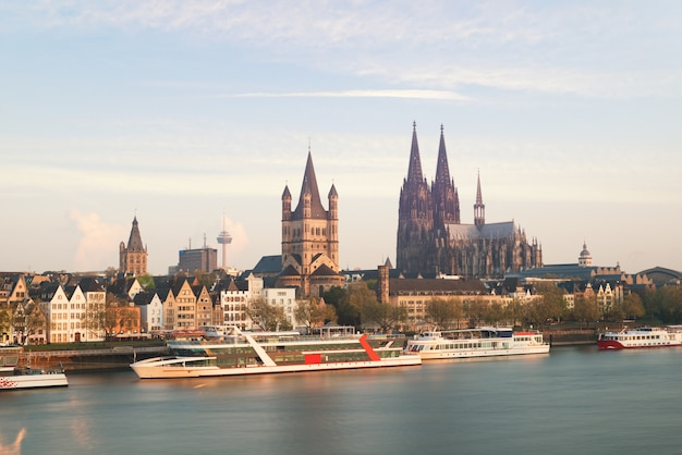 Aerial view cologne over the rhine river with cruise ship in morning at cologne, germany.