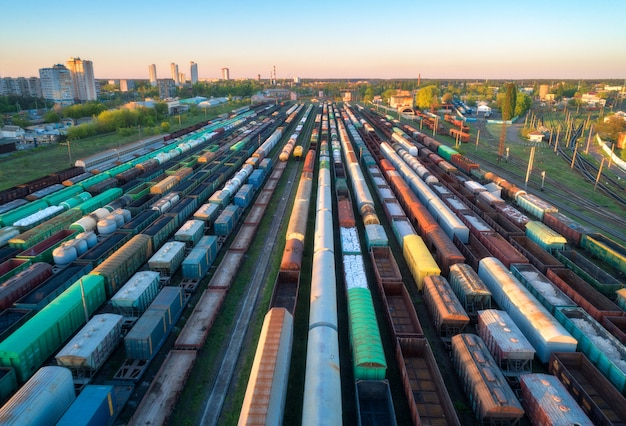 Aerial view of colorful freight trains on railway station at sunset