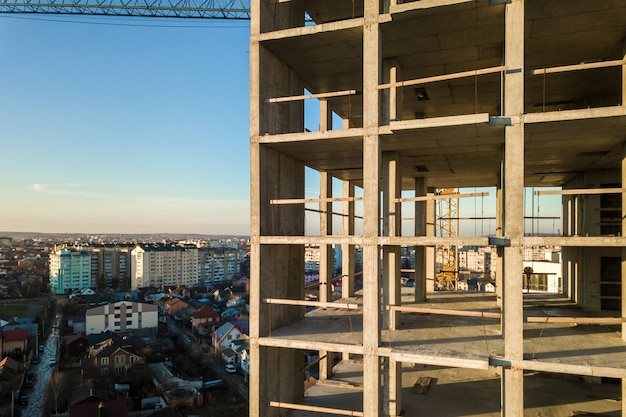 Aerial view of concrete frame of tall apartment building under construction