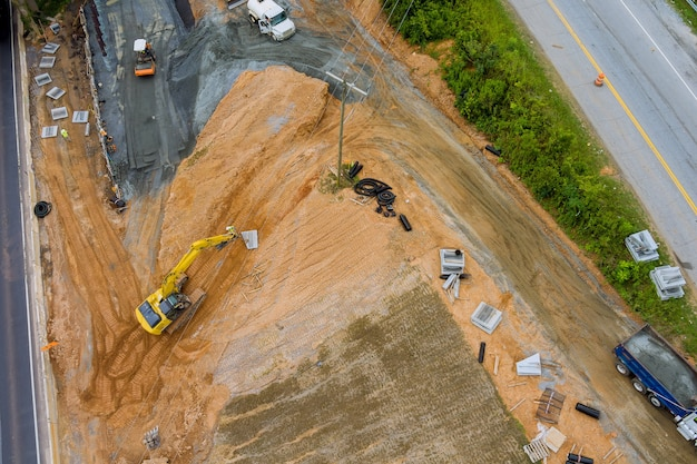 Aerial view construction of road interchange workers heavy machinery joining the reconstruction of highway in usa