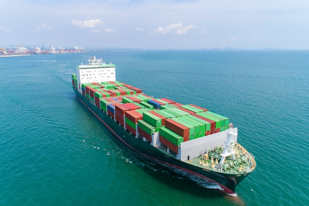 Aerial view container ship and  boat going to sea port for logistics shipping