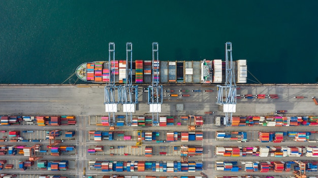Aerial view container ship carrying container in import export business logistic and transportation.