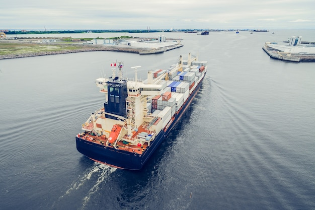 Aerial view of container ship going to port