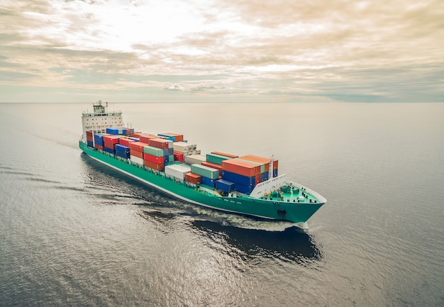 Aerial view of container ship sailing in the open sea
