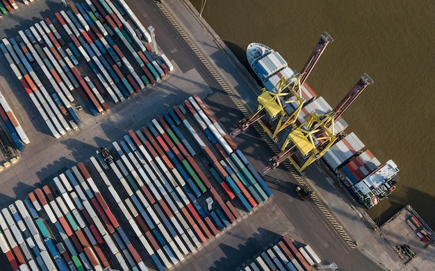 Aerial view of container terminal. ship unloading in sea port